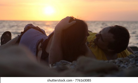Couple in love romantically lay under the sun look each other together during sunset time