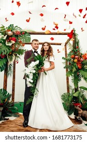 a couple in love with rose petals .wedding photo of a couple in a brightly decorated place
