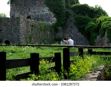 A couple in love with the ruins of the fort.In love couple disappointed in love.