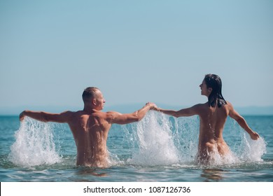 Couple in love with sexy body relax on beach. Summer holidays and paradise travel vacation. Love relations of naked couple in sea water. Sexy woman and man are free. happy family or valentines day