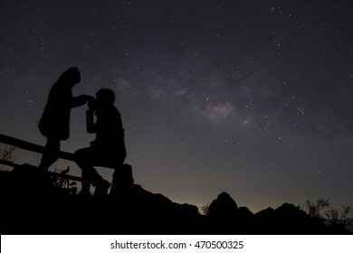 Couple in love silhouette and the Milky, love and valentines concept, long exposure astronomical photograph