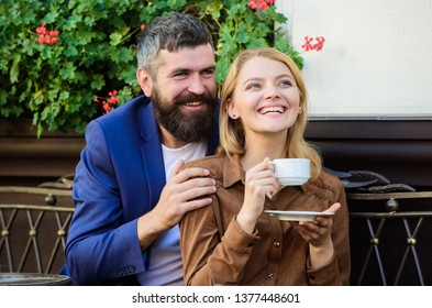 Couple in love sit hug cafe terrace enjoy coffee. Pleasant family weekend. Explore cafe and public places. Married lovely couple relaxing together. Happy together. Couple cuddling cafe terrace.