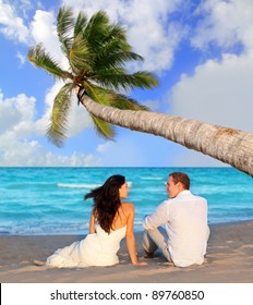 couple in love sitting in blue beach on vacation travel [Photo Illustration]