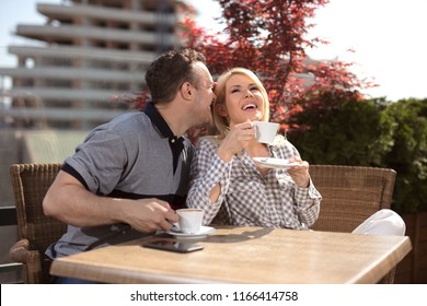 couple in love sitting in a cafe and communicating.Close up of a happy couple enjoying time together