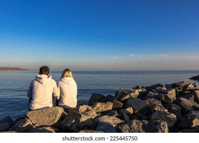 Couple in love sitting on the beach