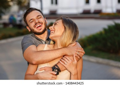 Couple in love smiling after walking around the city
