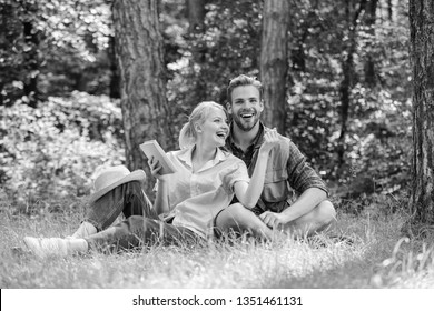 Couple in love spend leisure in park or forest. Romantic couple students enjoy leisure looking upwards observing nature background. Couple soulmates at romantic date. Romantic date at green meadow.