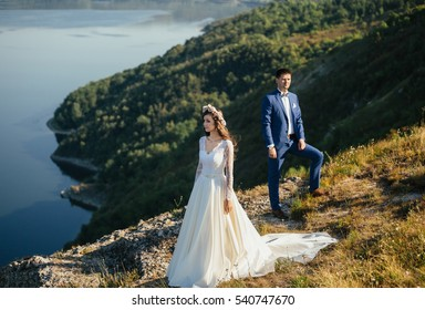 Couple in love standing on the hillside