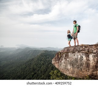 Couple in love standing on the mountain
