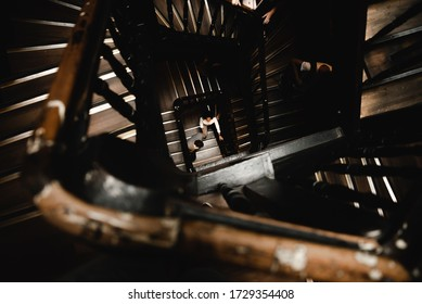 couple in love stands on a swirling staircase onto which light falls from above,couple down the stairs,top view of a couple standing near the stairs,lovers walk