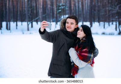 couple in love take selfie outdoor, winter
