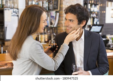 Couple in love takes a drink in restaurant, a tender moment