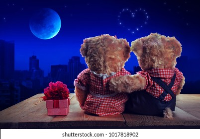 Couple love teddy bear looking to the super blue moon eclipse. Mixed media