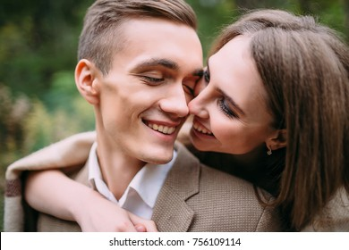 Couple in love tenderly touches by their noses. Happy newlyweds. Artwork. CLose-up