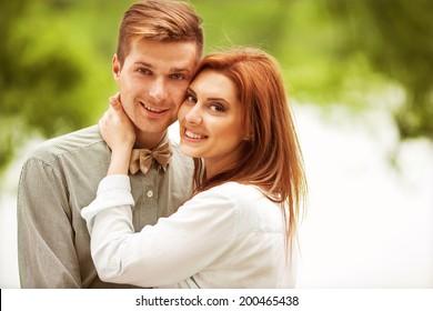 Couple in love walk near the riverr, smiling . Valentine's Day