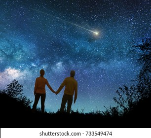 Couple in love watching the stars in night sky