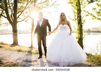 couple in love, wedding day, a girl in a wedding dress, a man in a tuxedo