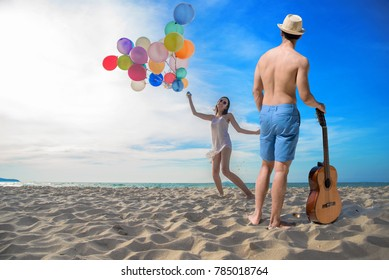 couple lover enjoy and happy together on the sea beach to celebrate for honeymoon, valentine anniversary