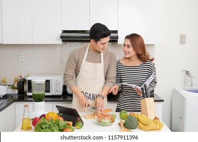 couple lover enjoy together cooking in home kitchen, joining prepare food together for extent relationship last longer concept