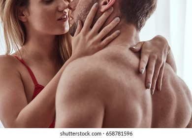 Couple of lovers embracing and kissing each other