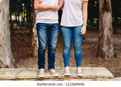 Couple of lovers with green sneakers and standing jeans