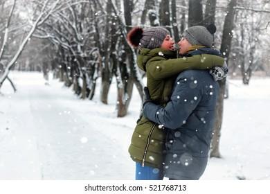couple lovers kiss winter street