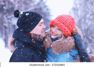 couple lovers man carries a girl in winter