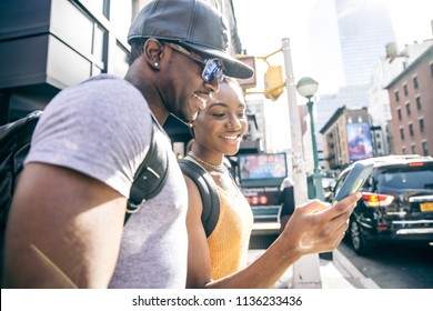 Couple of lovers in New York looking at smart phone