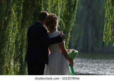 a couple of lovers on the shore of the lake