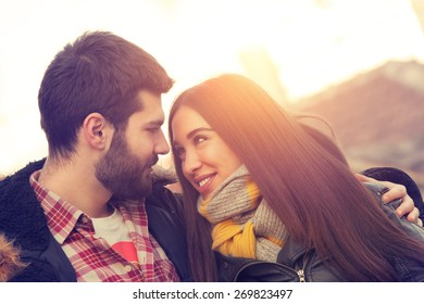 Couple loving each other outdoors.