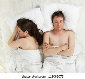 a couple lying in bed