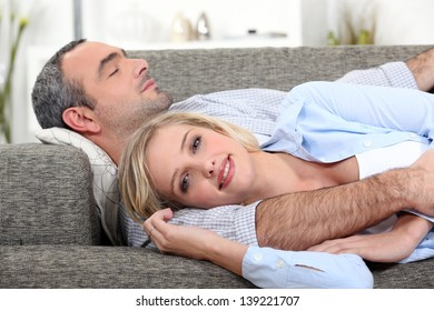 Couple lying on the couch