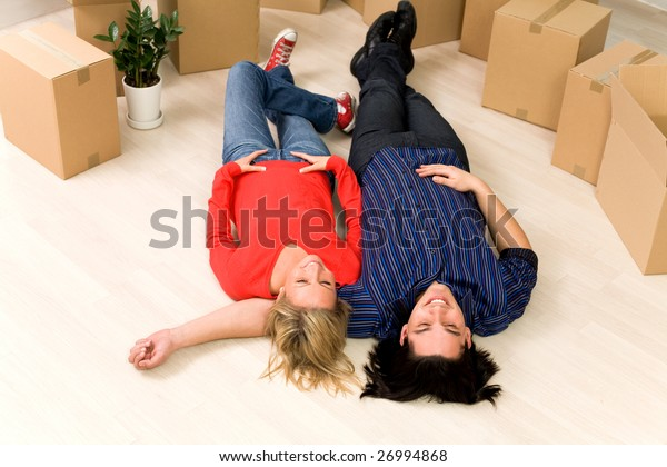 Couple lying on floor in new home
