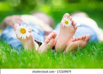 Couple lying on grass outdoors in spring park