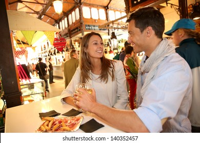 Couple in Madrid eating spanish savouries