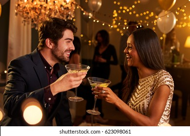 Couple Make Toast As They Celebrate At Party Together