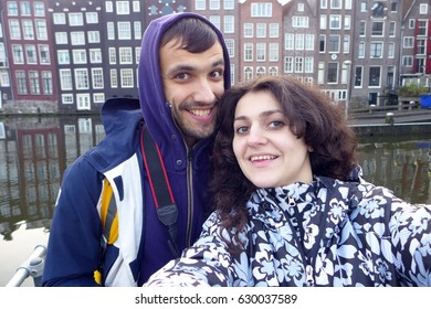 A couple makes selfie in Amsterdam