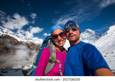 Couple makes selfie in the mountains on the way to Annapurna base camp