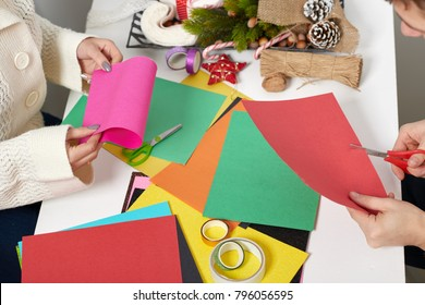 couple making decorations from paper for Valentine day, top view - romantic and love concept