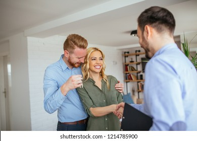 Couple making dill with real estate agent about new apartment