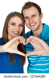Couple making heart gesture of love
