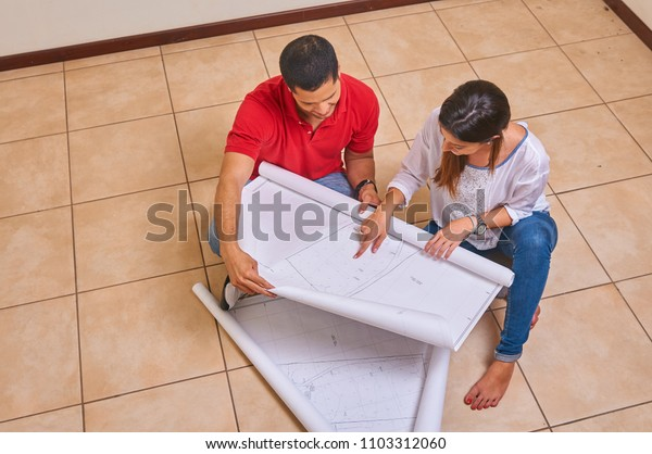 Couple making plans in new home