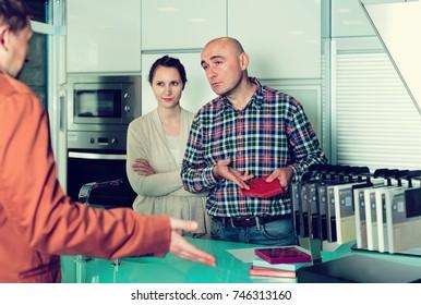 Couple making scandal at kitchen furniture  store