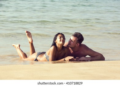 couple man and woman on the beach in summer