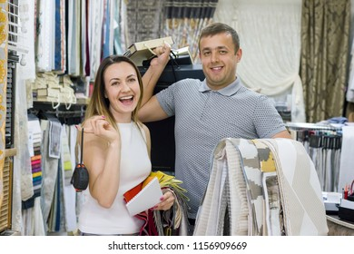 Couple is man and woman, owners of small family business. Show-room shop of home textiles, fabrics, curtains