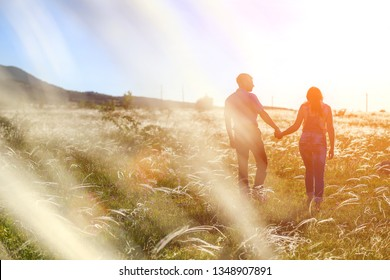 couple man and woman relationship in nature in the setting sun