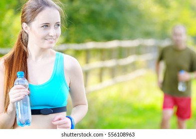 Couple of man and woman running outdoors summer time
