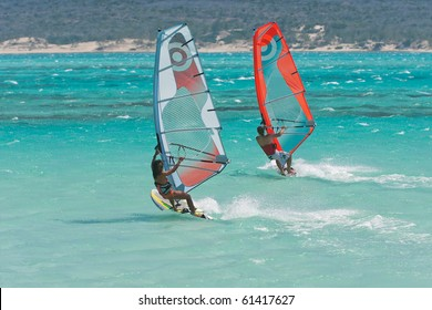 Couple man and woman windsurfing in the lagoon