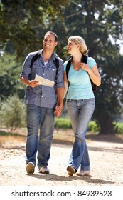 Couple with map on country walk