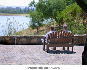 Couple of men sitting on bench